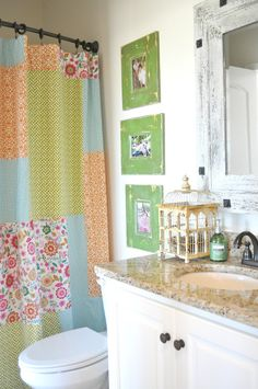 Super cute bathroom.  That shower curtain would be super easy to make too.