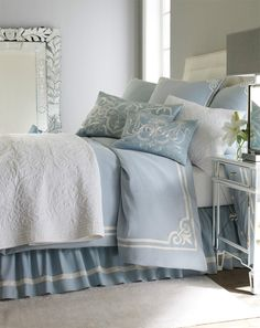 light blue traditional chic bedroom mirrored bedside table white headboard2