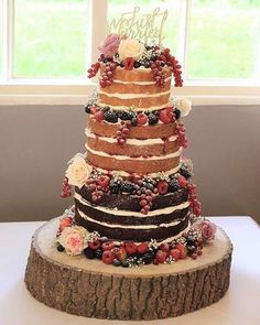 Yummy naked wedding cake full of flavours topped with delicious berries , naked wedding cakes
