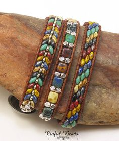 A stylish Bohemian bracelet. Its beaded with the popular SuperDuos and Czechmate Tiles which are pressed glass beads made in the Czech Republic. The beads are Southwestern Picasso colors-turquoise, white, red, blue, mustard, and black. Silver Tibetan beads have been added for