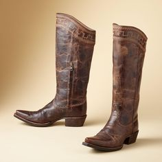 "SAHARA TALL BOOTS -- Tone-on-tone stitching brings out subtle shifts in color in Ariat®'s richly textured and gently distressed boots. Imported. Whole and half sizes 6 to 10, 11. Approx. 1-3/4"" heel."