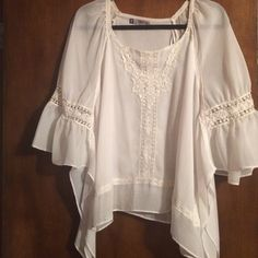 Free flowing blouse,,, A lot of detail on this free flowing blouse. Size M. Sleeves are 3/4 length and are attached at a bag wing type. Really cute with leggings. Jennifer Lopez Tops Blouses