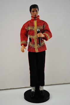 Michael Jackson doll from 1984. He is wearing the authentic stage outfit from the American Music Awards. Included is his microphone, red and gold