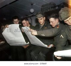 Elvis Presley (with hat) and his comrades study a map. The American Rock'n Roll singer was stationed in Friedberg (Hesse) in the context of his military service in the US Army in the 1950s and will leave Germany from Frankfurt am Main in a military airplane on the 2nd of March in 1960. Stock Photo