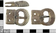 LON-FE5446: A Medieval buckle made from animal skeletal material (bone) with integral plate dating to the 12th century.