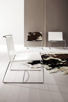 The Fil fireside chair by Pascal Mourgue 2003. Popular in cowhide but comes other colours of leather and felt too.