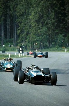 Pedro Rodriguez (Cooper Car co.) leading Jack Brabham (Brabham Racing Organisation) into Malmédy during the 1967 Belgian Grand Prix at Spa-Francorchamps ""