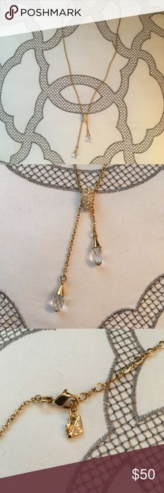 Gold Swarovski lariat necklace with crystals Gold Swarovski lariat necklace with crystals! Swarovski Jewelry Necklaces