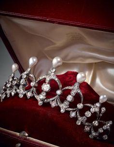 A tiara, 19th century, composed of foliate and scroll motifs set with old cut diamonds, drop pearls, and in gold, silver