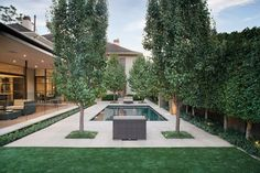contemporary landscaping by Jack Merlo Design; covered to backyard