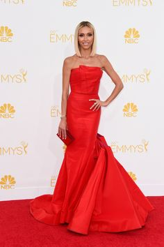 TV personality Giuliana Rancic attends the 66th Annual Primetime Emmy Awards showing off her new blonde hair and gorgeous red Gustavo Cadile gown with pockets of purple. via @stylelist