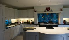 This house is Rickmansworth is home to one of our beautiful splashbacks. Two, actually, as you can see in the images, they both match and bring a lot of personality and colour to the kitchen. With primarily blue hues and a design that shows quite a variety of fish, we're sure that the splashback will impress anyone who enters the house.