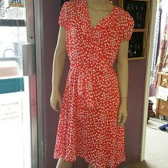 """Orange & white polka dot flowy dress. Size 16 Orange & white polka dot flowy dress with poet style ruffled neckline. Belt. Lined with a solid coor lining. 100% polyester. Measures approx. 42"""" in length. Small ruffle around sleeves. Size 16. Pulls over head, no zipper. Very good condition. Voir Voir Dresses Midi"""