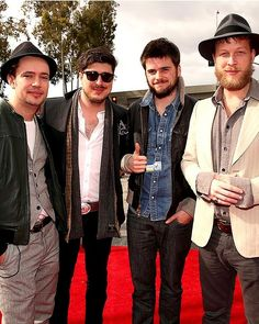 LOS ANGELES, CA - FEBRUARY 10:  Ben Lovett, Marcus Mumford, 'Country' Winston Marshall and Ted Dwane of Mumford & Sons arrive at the 55th Annual GRAMMY Awards on February 10, 2013 in Los Angeles, California.  (Photo by Christopher Polk/Getty Images for NARAS)