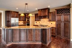 What a great color concept for a kitchen, very warm.