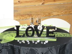 Black and Apple Green Sweetheart Table for reception!