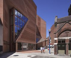 Built by O'Donnell + Tuomey Architects in London, United Kingdom with date 2013. Images by Dennis Gilbert. Street Life - within and without the building  The site is located at the knuckle-point convergence of the network of...