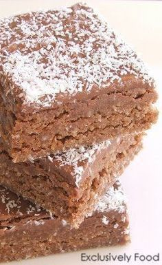 This moist chocolate coconut slice is quick and easy to make. Preparation time: about 20 minutes (excludes baking time). Makes 16 pieces . Coconut Recipes, Baking Recipes, Cake Recipes, Dessert Recipes, Desserts, Chocolate Coconut Slice, Chocolate Cale, Chocolate Treats, Chocolate Chocolate
