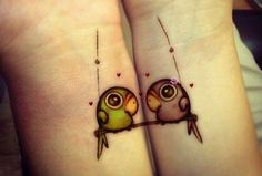 Cute parrot couple tattoo