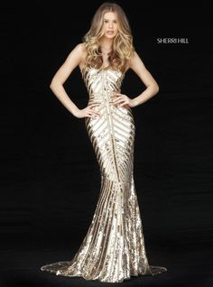 This Sherri Hill 51206 fitted prom dress is styled in chevron-patterned sequins, with beaded spaghetti straps supporting the V-neckline and low back. This metallic gown finishes in a modestly flared hem and court train.