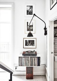 Corner with a retro lamp, a record player, and black and white photography