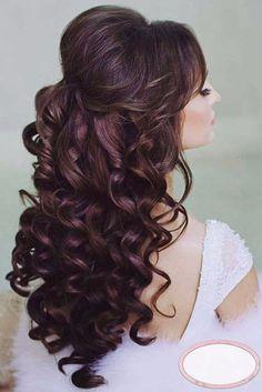 Acconciatura da sposa per capelli semi raccolti mossi