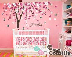 In Stock at www.wallconsilia.com  Spring inspired nursery tree decal with butterflies and blossoms. Indulge your little one's imagination with this stunning vinyl wall decal set perfect for any nursery or bedroom. We think it's a great choice for gender neutral nursery!