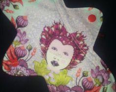 "Crimson Moon cloth mentrual pads range from 8"" to 18"" long."