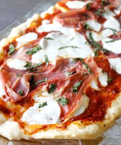 Prosciutto Pizza with Mozzarella and fresh Basil cooked on the smoker.