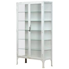 This medical cabinet was produced in the 1940s in Hungary. The cabinet is made from thick iron and glass. With the original lock and handle. It features five new glass shelves. Glass Front Cabinets, Glass Cabinet Doors, Glass Shelves, Small Curio Cabinet, Tall Cabinet Storage, Medicine Cabinet, Display Cabinet Lighting, Vintage Medical Cabinet, Vitrine Vintage