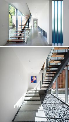 Wood and steel stairs pass by the windows and lead you to the various floors of this home.