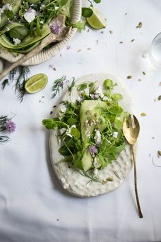 summer salad with cucumber, rocket, goats cheese and seeds served with a lime and avocado dressing