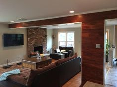 Gorgeous accent wall covered with acacia - flooring isn't just for your floor anymore!