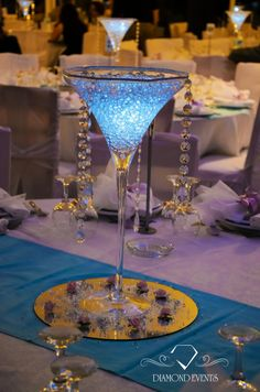 Wedding Centerpiece idea using a Tall Martini Glass. Try filling your simple container with Aqua Crystals, submersible LED lights, and Crystal Swag to make it pop. Visit us to purchase your centerpiece supplies #AquaCrystals #VesselsAndVases https://www.WedCrafts.com Amanda@WedCrafts.com