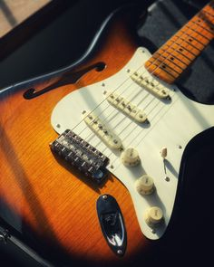 #Straturday What do you think of the classic sunburst and f-hole on this Fender Eric Johnson Thinline Stratocaster? A cool custom instrument, available now at elderly.com. Eric Johnson, Black Dots, Electric Guitars, Playing Guitar, Vintage Fashion, Classic, Music, Pretty, Model