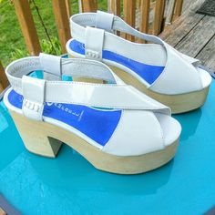 "NWOT Jeffrey Campbell White Patent  Falk Platforms Purchased as NWOTs, but sadly do not fit me well, so here they are! White, patent leather, 2"" front platform w/ 4"" heel, light toned wood, lightweight Jeffrey Campbell Falk sandals. In superb condition (1 small indent in wood on front of right sandal and a light mark on back of left sandal..see pics). Size 8 and seem true to size (I'm a 7.5, but sometimes prefer an 8 and they did not fit me well). Elastic back for easy on & off. Get these…"