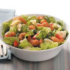 Tortellini-Shrimp Caesar Salad Recipe -This fun, main dish salad dresses up ordinary Caesar salad with two surprise ingredients, cheese tortellini and popcorn shrimp. The result is a fantastic and filling combo.