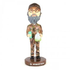 I totally want this for my desk at work..Duck Dynasty Si Bobblehead (complete with jug of tea and cup!)