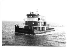 A photo of the tug Ernest H. Doss on a trial run in Pensacola Bay after she received new Detroit Diesel 16-149 engines to replace the Cat D397 engines that she had.