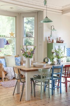 """Vintage, cottage dining room- mismatched chairs can sometimes create a positive """"lived-in"""" feel."""