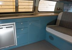 Dubteriors T2 Bay window interior in VW Neptune Blue with oak worktops