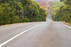 Long and winding road running through forests, Kangaroo Island, Australia.