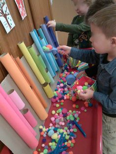 Inviting fine motor activity.  Note the space between the short tubes to provide a view of the pathway as the objects continue to fall.  Consider adding clear tubes and some objects that might fall at different rates.