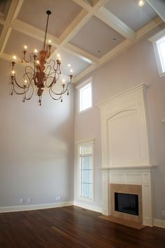 Two story great room with double tier fireplace and coffered tray ceiling in the Diana plan.