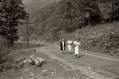"September 1938. ""Miners' wives coming home from town with groceries on payday near Mohegan, West Virginia."" 35mm nitrate negative by Marion Post Wolcott for the Farm Security Administration."
