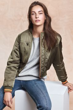 The vibe is a mix of sleek staples and sportswear; bomber jackets, track pants, sweatshirts and dresses. | H&M Fall/Winter