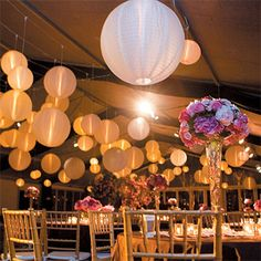 Brides.com: Melanie and Scott in Houston, TX At the reception, held in a tent set up over the tennis court, paper lanterns provided a romantic glow and the centerpieces included hydrangeas and roses. The event and floral décor was provided by Rebekah Johnson of Bergner & Johnson Design.Bride: Melanie FrenchGroom: Scott RothwellLocation: Houston, TX