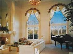 Arched window treatments are the perfect answer for Palladian-style windows. Learn more about how to choose window treatments for different windows. Drapes And Blinds, Blinds For Windows, Window Curtains, Shades Blinds, Bay Window, Arched Window Treatments, Window Coverings, Arched Doors, Arched Windows