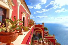 red homes over the sea.