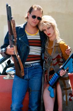 Mickey and Mallory Knox in Natural Born Killers (1994) My favorite Love Story. Want this costume for halloween